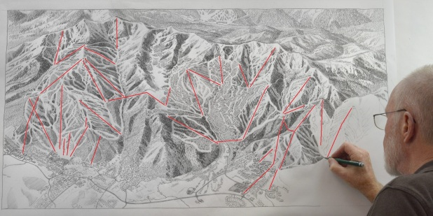 James Niehues paints the new PCMR trail map.