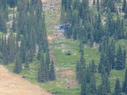 Brian Jorgenson from Timberline Helicopters flies concrete for the new Teton Lift  earlier this week.